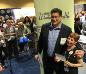 PeriGen CEO Matt Sappern hands AWHONN a donation for Every Woman, Every Baby research fund