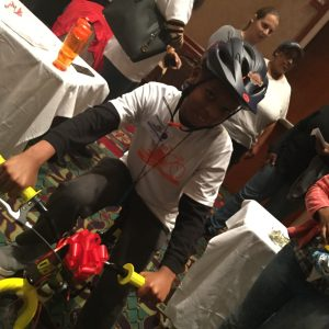 """Littles"" from Cary's Big Brothers, Big Sisters organization enjoyed riding their new bikes around the conference room"