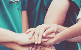 Clinicians hands together